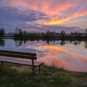 Empty bench at sunset by Dražen Škrinjarić - Landscapes Sunsets & Sunrises ( orange, europe, bench, grass, colorful, twilight, romantic, croatia, reflections, zagreb, scenic, house, yellow, red, tree, autumn, color, blue, sunset, moody, nostalgic,  )