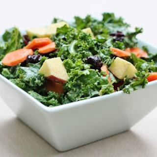 Kale Salad with Carrots, Apples, Raisins, and Creamy Curry Dressing.