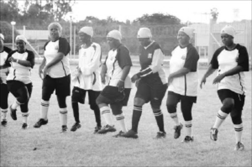 RARE BREED: Vakhegula Vakhegula, the soccer-playing grannies from Tzaneen, training for next month's trip to Massachusetts in the US. They have captured the imagination of the world but need funding. Pic. ELIJAR MUSHIANA. 26/05/2010. © Sowetan.  26 MAY 2010 WEDNESDAY: GO USA: Limpopo soccer playing grannies, Vakhegula-vakhegula from Tzaneen are training in preparation for their trip to  USA in July. They are still struggling to raise funds for a flight, accomodation and food, They raised R100 000 and the balance is R400 000. PHOTO: ELIJAR MUSHIANA