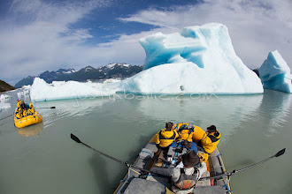 """Photo: Rowing accross Lake Alsek past ice bergs while on a raft trip down the Tashenshini River. The """"Tat"""" flows out of Yukon, CA, through British Columbia and empties into Glacier Bay National Park in Alaska, US."""