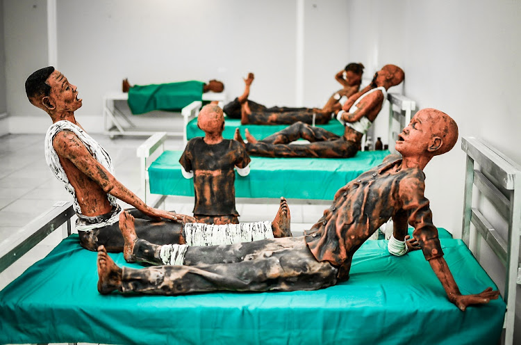 The exhibition includes this piece by Lumanyano Gosani, titled 'The Collapse: Ceramist's Commentary On Dilapidated Public Healthcare in the Eastern Cape'.