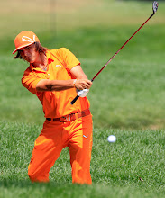 Photo: AKRON, OH - AUGUST 07:   Rickie Fowler hits an approach shot on the second hole during the final round of the World Golf Championships-Bridgestone Invitational on the South Course at Firestone Country Club on August 7, 2011 in Akron, Ohio.  (Photo by Sam Greenwood/Getty Images)