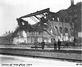 Photo: men viewing the demolition of fire remains at site of future union station f1244_it0014