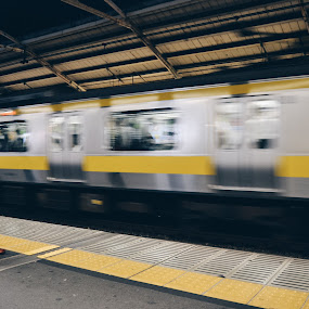 Train waiting by Valentina Cantera - Transportation Trains ( move, waiting, japan, asia, yellow, transport, transportation, tokyo, subway, fast, underground, men, stand up, man, railway, movement, train )