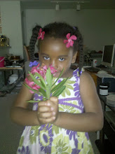 Photo: during their daily morning walk on June 3, Kaleya picked flowers