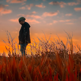 Contemplate by Apollo Reyes - People Portraits of Men ( dawn, sky, grass, dusk )
