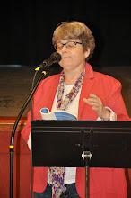 Photo: Terry Busch reads her work.