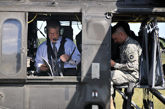 Photo: United States Senator Al Franken, the Great State of Minnesota, prepares for his over view flight at Camp Ripley on Aug 25, 2010.  Senator Franken made the trip to Camp Ripley to gain a better understanding of all things the facility has to offer for training the Guard and the various civilian agency partners Camp Ripley has. (photo by 1st Lt. Kenneth R. Toole, Camp Ripley Public Affairs Officer)