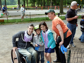 Photo: NYC Disabilities Commissioner, Victor Calise and his daughter presenting a GallopNYC rider with a ribbon!