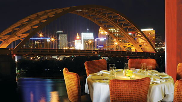 A set restaurant table with the skyline of Cincinnati in the background