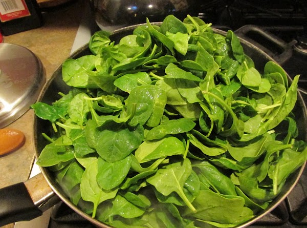 Add washed baby leaf spinach to skillet, add salt and pepper & optional minced...