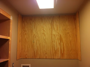 """Photo: Instead of prebuilding these cabinets, I chose to build them into the wall using some 1/4"""" bead board."""