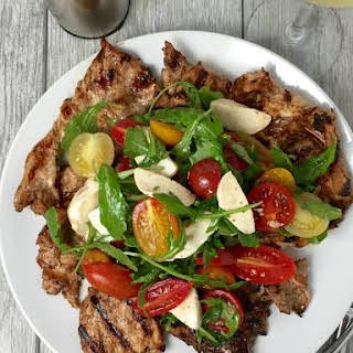 Grilled Chicken Paillard with Arugula, Mozzarella & Cherry Tomato Salad.