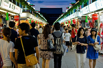 Photo: A couple walks down the famous Nakamise street in Asakusa, Japan.