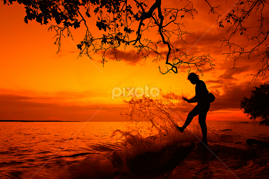 Kick the wave by Imansyah Putra - People Street & Candids ( fineart, pwcsilhouettemotion, silhouette, street, candid, beach, people )