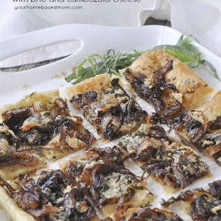 Caramelized Onion Tart with Brie and Cambozola Cheese.