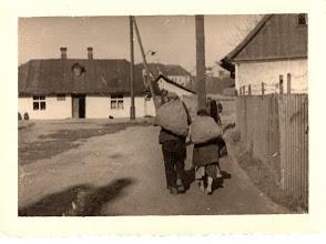 Photo: 10-27-40. Jewish couple carrying coals.