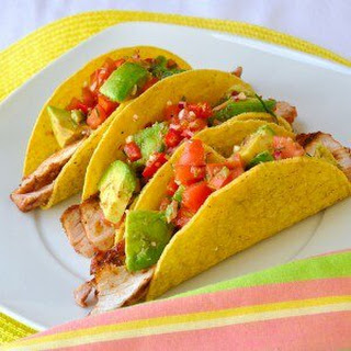 Spicy Barbeque Pork Chop Tacos with Chunky Avocado Salsa.