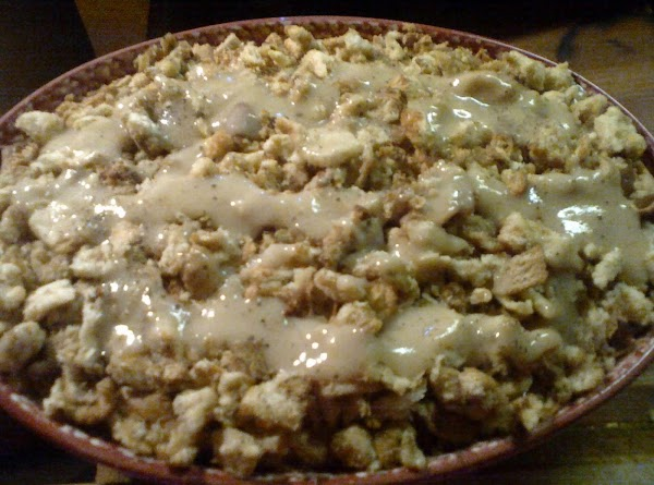 Top with enough gravy to just cover thinly; put a layer of the stuffing....