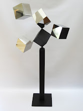 Photo: 24 REFLECTIONS AND A VOID - 58H X 27W X 12D Polished Stainless Steel, Painted Mild Steel, Front View