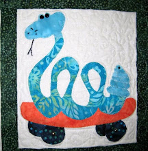 Photo: A closer lok at the snake block in the quilt by Needles and Friends Quilt Guild in Liberal, Kansas for a fundriaser.