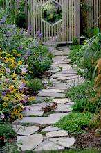 Photo: Plantings should soften pathways for a more welcoming feel.