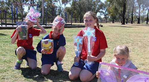 PREPARATION TIME: Narrabri West Public School students Georgia Thomas, 9 (Year 3), Lachie Nott, 7 (Year 1), Mikayla Smetanin, 11 (Year 5) and Ivy Boehm, 5 (kindergarten) with some of the goodies ahead of the school's annual fete on Friday evening.