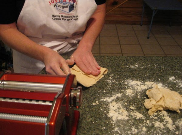 Place dough in the pasta machine and roll it through. Or roll flat on...