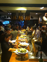 Photo: Another pincho bar--notice the hams hanging from the ceiling.