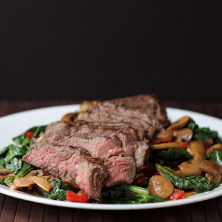Bison Ribeye with Hot Spinach Salad