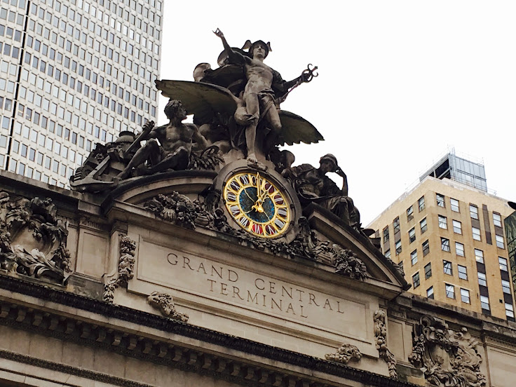 Mercury stands on top of the Grand Central facade.