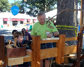 Photo: Jim Allison amazed the little ones with his skill at the pole lathe.