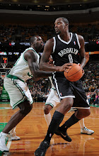 Photo: BOSTON, MA - OCTOBER 16:  Andray Blatche #0 of the Brooklyn Nets with the ball against Brandon Bass #30 of the Boston Celtics on October 16, 2012 at the TD Garden in Boston, Massachusetts. NOTE TO USER: User expressly acknowledges and agrees that, by downloading and or using this photograph, User is consenting to the terms and conditions of the Getty Images License Agreement. Mandatory Copyright Notice: Copyright 2012 NBAE  (Photo by Brian Babineau/NBAE via Getty Images)