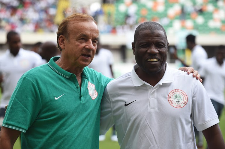 German Gernot Rohr (L), fired as Nigeria head coach after the 2018 FIFA World Cup in Russia, poses with his then deputy coach Salisu Yusuf (R) during the 2017 Africa Cup of Nations qualification match between Nigeria and Tanzania in Uyo, Akwa Ibom State, on September 3, 2016. Yusus, who replaced Rohr after the World Cup, is banned for 12 months after receiving money from journalists posing as agents, the Nigeria Football Federation announced on Wednesday September 5 2018.