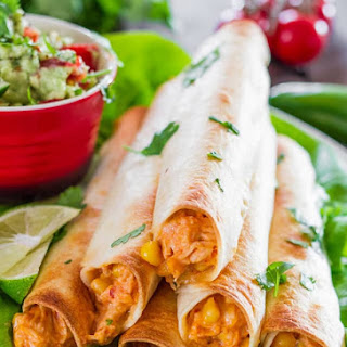 Baked Creamy Cheesy Chicken Flautas with Guacamole.