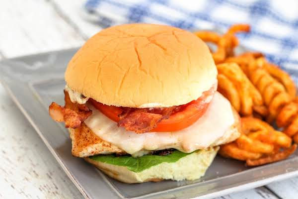 Cajun Chicken Blt On A Plate With French Fries.