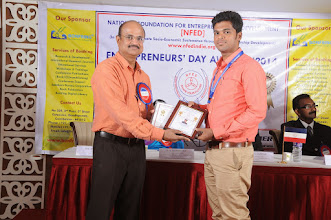 Photo: Chief Guest Mr. A. Devi Dutt Issuing Young Entrepreneur Award to Mr. Santhosh Duraisamy, Co-Founder & Managing Partner, Bonfirng, Coimbatore
