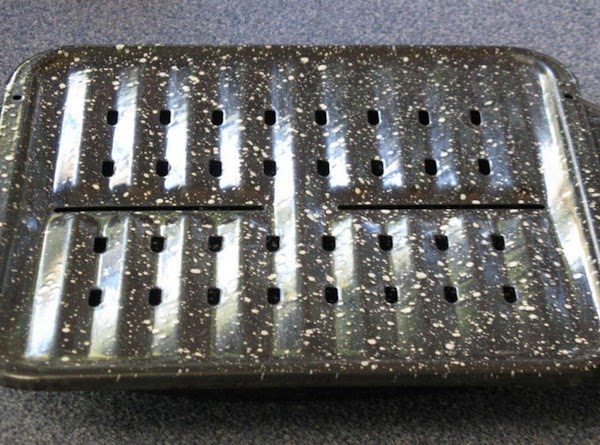 Cover broiler pan inside with foil. Cover top with foil, punch in the holes...