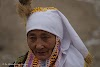 Mongolia. Golden Eagle Festival Olgii. Old Lady in beautiful dress