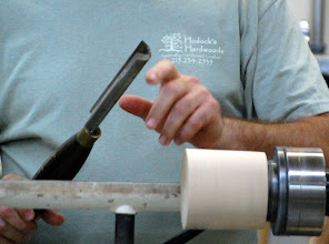 Photo: Mike shows his modification to his roughing gouge with the sides ground back....