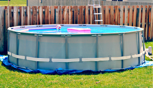 Photo: A few weeks ago we bought this Intex pool from Sears but it's a bit of an eye sore in the backyard. We went to Sears to find some pool side decor.