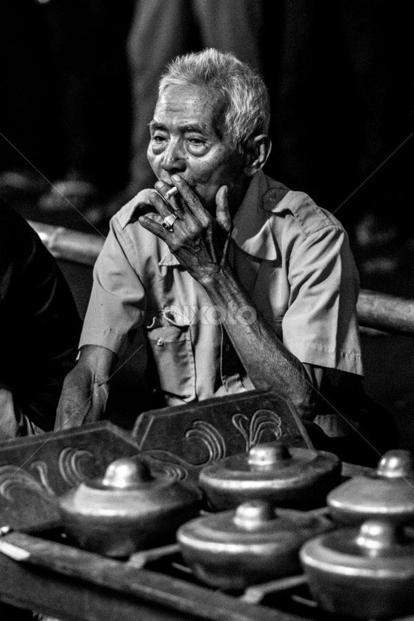 Old Gamelan Player by Irwin Day - People Portraits of Men ( gamelan, smoking, indonesia, banyumas, street, java, old man, portrait )