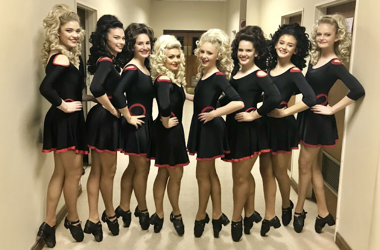 "McWilliams Academy of Dance members, from left, Jenna Hayes, Carma Stephenson, Irene Pitsiladi, Courtney Pearce, Jemima Opperman, Tammy Forbes, Channaed Oosthuizen and Sarah Sharp danced at ""Last Night of the Proms"""