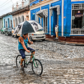 Riding in the Rain by Richard Michael Lingo - City,  Street & Park  Street Scenes ( rain, city, street scene, street, cuba )