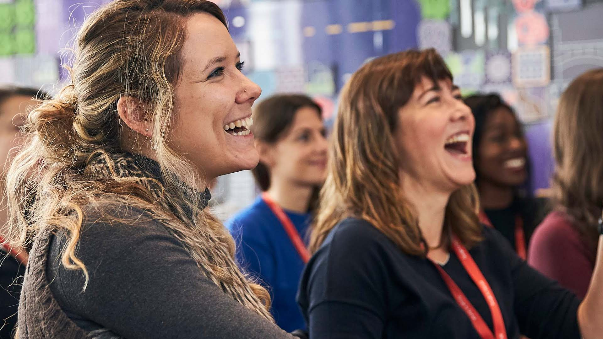 2 women in a conference, laughing