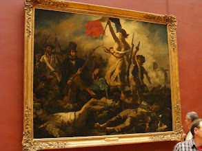 Photo: Delacroix's Liberty Leading the People (commemorating the July Revolution of 1830, which toppled Charles X) has inspired generations of French patriots. From the Louvre Web site: The peak of fervor occasioned by victory is represented in a pyramidal composition; the base, strewn with corpses, resembles a pedestal supporting the image of the victors. Delacroix had used a similarly rigorous composition for his painting entitled Greece on the Ruins of Missolonghi, and a comparable structure is apparent in Géricault's Raft of the Medusa. Here, it serves to contain and balance the painter's vigorous brushwork, and the impetuous rhythm of the scene. The allegory of Liberty is personified by a young woman of the people wearing the Phrygian cap, her curls escaping onto her neck. Vibrant, fiery, rebellious, and victorious, she evokes the Revolution of 1789, the sans-culotte, and popular sovereignty. In her raised right hand is the red, white, and blue flag, a symbol of struggle that unfurls toward the light like a flame. The composition is given unity by the painter's particularly skilful use of color; the blue, white, and red elements have counterpoints; the white of the parallel straps across the fighters' shoulders echoes that of the gaiters and of the shirt on the corpse to the left, while the gray tonality enhances the red of the flag.