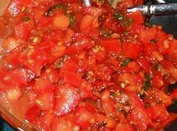 In a large bowl, combine the roma tomatoes, sun-dried tomatoes, garlic, olive oil, vinegar,...