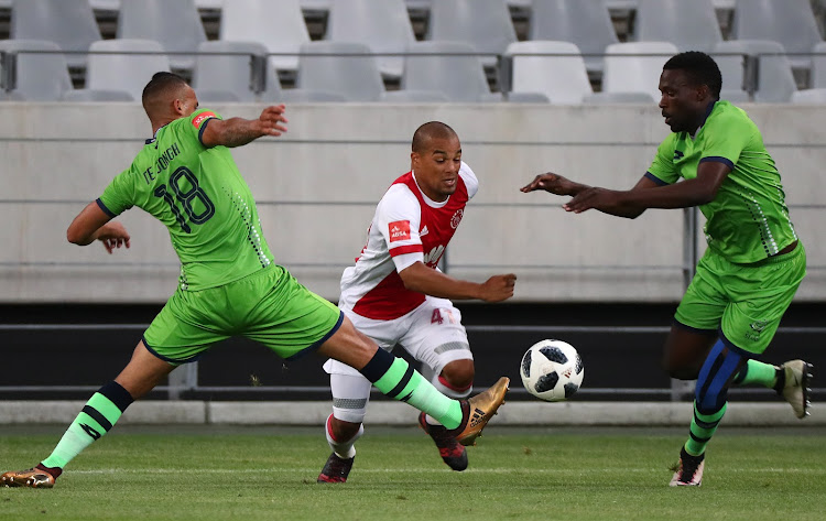 Fagrie Lakay of Ajax Cape Town challenged by Ryan de Jongh of Platinum Stars (l) and Willem Mwedihanga of Platinum Stars (r) during the Absa Premiership 2017/18 football match between Ajax Cape Town and Platinum Stars at Cape Town Stadium, Cape Town on 12 January 2018.