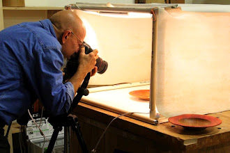 Photo: Mike Colella taking Gallery pictures of Jimmy Clewes Workshop projects -- two colored-rim platters