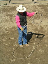 Photo: Next, put the hondo in your left-hand, with the coils, and take the right-hand with two-pieces of lariat, down to your right. Your have just created the 'spoke'. It should be about 1/3rd of the entire loop. Although that can vary.